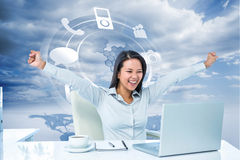 Composite image of happy businesswoman with raised arms Stock Photo