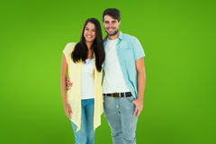 Composite image of happy casual couple smiling at camera Stock Photography
