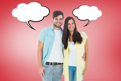 Composite image of happy casual couple smiling at camera Royalty Free Stock Photos