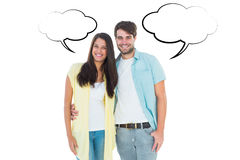 Composite image of happy casual couple smiling at camera Royalty Free Stock Photography