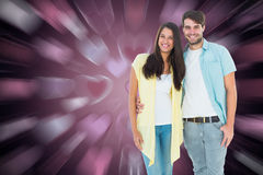 Composite image of happy casual couple smiling at camera Stock Photo