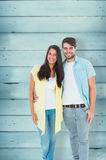 Composite image of happy casual couple smiling at camera Stock Photos