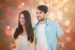 Composite image of happy casual couple smiling together Stock Photos