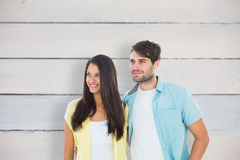 Composite image of happy casual couple smiling together Stock Photo