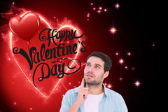 Composite image of happy casual man thinking with hand on chin. Happy casual man thinking with hand on chin against valentines heart design Royalty Free Stock Photos