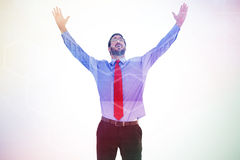 Composite image of happy cheering businessman raising his arms Stock Photos