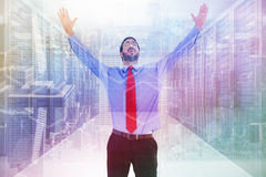 Composite image of happy cheering businessman raising his arms Royalty Free Stock Photography
