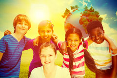 Composite image of happy children forming huddle at park Stock Images
