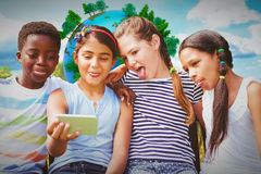 Composite image of happy children taking selfie at park Royalty Free Stock Photos