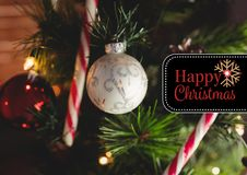 Composite image of happy christmas message against christmas decoration Stock Image