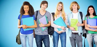 Composite image of happy college students holding folders. Happy college students holding folders against blue background with vignette Royalty Free Stock Photos