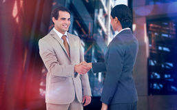 Composite image of happy corporate man doing handshake Royalty Free Stock Images
