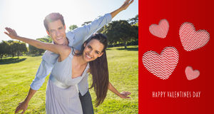 Composite image of happy couple with arms outstretched at park Royalty Free Stock Photo