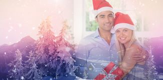 Composite image of happy couple at christmas Royalty Free Stock Images