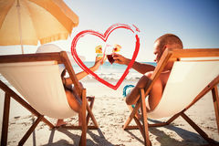 Composite image of happy couple clinking their glasses while relaxing on their deck chairs. Happy couple clinking their glasses while relaxing on their deck stock photos