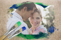 Composite image of happy couple in the countryside Stock Photo