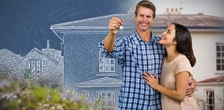 Composite image of happy couple embracing while holding home keys stock photo