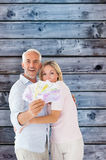 Composite image of happy couple flashing their cash Royalty Free Stock Photo