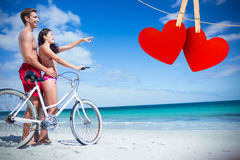 Composite image of happy couple going on a bike ride stock photos