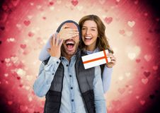 Composite image of happy couple holding a gift card Stock Photography