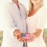 Composite image of happy couple holding their hands out Royalty Free Stock Photography
