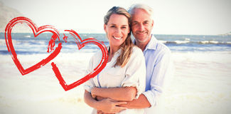 Composite image of happy couple hugging on the beach woman looking at camera Royalty Free Stock Photography