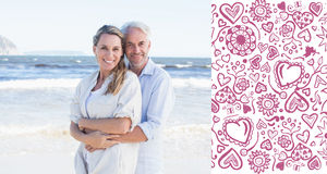 Composite image of happy couple hugging on the beach woman looking at camera Royalty Free Stock Photo