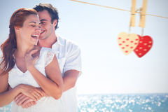 Composite image of happy couple hugging and laughing together Royalty Free Stock Photos