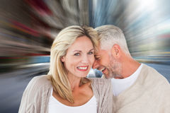 Composite image of happy couple laughing together woman looking at camera. Happy couple laughing together women looking at camera against new york street Royalty Free Stock Image