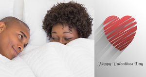 Composite image of happy couple lying in bed under the duvet. Happy couple lying in bed under the duvet against cute valentines message stock illustration