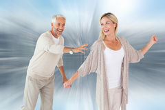 Composite image of happy couple messing about together Stock Photography