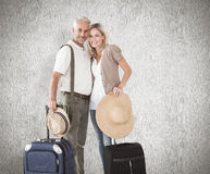 Composite image of happy couple ready to go on holiday Stock Photos