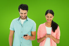 Composite image of happy couple sending text messages Stock Photography