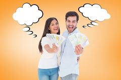 Composite image of happy couple showing their money Stock Photos