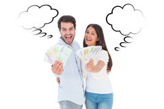 Composite image of happy couple showing their money Royalty Free Stock Photo