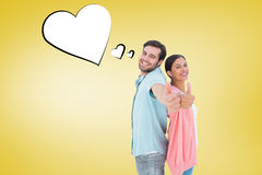 Composite image of happy couple showing thumbs up. Happy couple showing thumbs up against yellow vignette Royalty Free Stock Photography