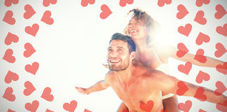 Composite image of happy couple smiling Royalty Free Stock Image