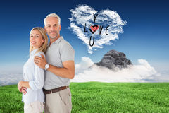 Composite image of happy couple smiling at camera Stock Image