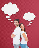 Composite image of happy couple smiling at camera Royalty Free Stock Image