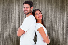 Composite image of happy couple smiling at camera Stock Images