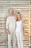 Composite image of happy couple smiling at camera together Stock Photography