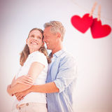 Composite image of happy couple smiling at each other royalty free stock images