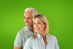 Composite image of happy couple smiling and embracing Royalty Free Stock Photos