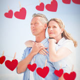 Composite image of happy couple spending time together stock photo