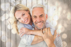 Composite image of happy couple standing and hugging Royalty Free Stock Images