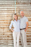 Composite image of happy couple standing and smiling at camera royalty free stock image