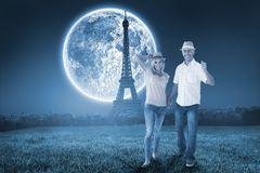 Composite image of happy couple walking holding hands Stock Photography