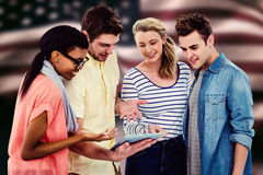 Composite image of happy creative team using a tablet pc Royalty Free Stock Photos