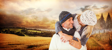 Composite image of happy cute couple romancing while embracing each other Royalty Free Stock Photography