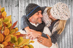 Composite image of happy cute couple romancing while embracing each other Royalty Free Stock Photos